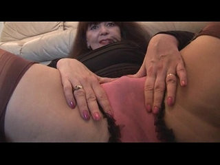 Busty mature with her hairy pussy in mini skirt plays with panties and teases