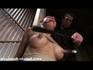 Bondage slave clamped and whipped